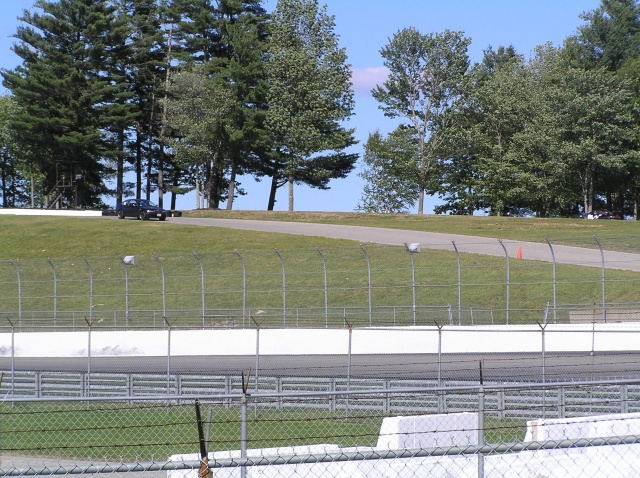 330i crests the hill at New Hampshire Motorsports Park