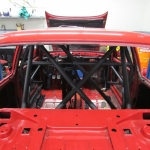 A view through the rear glass at the roll cage