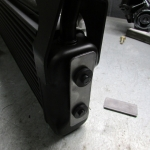 machined end plate for oil cooler mounting